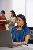 Indian businesswoman wearing headset — Stock Photo