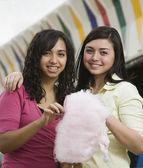 Multi-ethnic teenaged girls eating cotton candy — Stock Photo