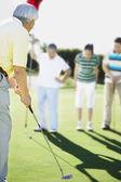 Senior Asian man playing golf — Stock Photo