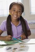 African American girl doing homework — Stock Photo