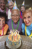 Senior Mixed Race man celebrating birthday — Stock Photo
