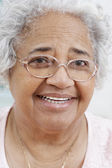 Senior African American woman smiling — Stock Photo
