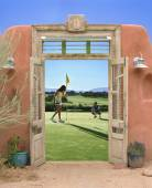 View through doorway to couple playing golf — Stock Photo