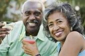 Senior African couple toasting with cocktails — Stock Photo