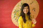 Asian woman holding parasol — Stock Photo