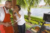 African couple barbecuing — Stock Photo