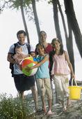 Multi-ethnic family at beach — Stock Photo