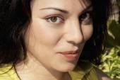 Hispanic woman pursing lips — Stock Photo