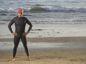 Hispanic man wearing wetsuit and goggles — Stock Photo