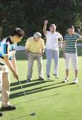 Asian man playing golf — Foto Stock