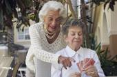 Senior women playing cards — Stock Photo