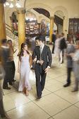 Young Hispanic couple walking arm in arm — Stock Photo