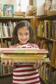 Pacific Islander girl holding library books — Stock Photo