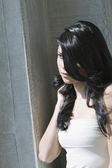 Hispanic woman with long hair — Stock Photo