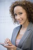 African businesswoman holding electronic organizer — Stock Photo