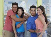 Multi-ethnic couples hugging — Stock Photo