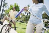 Multi-ethnic couple riding bicycles — Foto de Stock