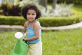 African girl holding watering can — Stock Photo