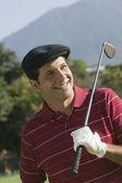 Латиноамериканский гольф-клуб холдинга человека через плечо — Стоковое фото