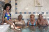 Group of seniors in hot tub — Stock Photo