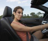 Hispanic woman driving convertible — Stock Photo