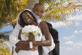 African bride and groom hugging — Stock Photo