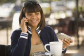 African teenaged girl talking on cell phone — Stock Photo