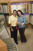 Multi-ethnic couple in flooring store — ストック写真