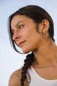 Hispanic woman with braid — Stockfoto