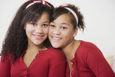 African twin sisters hugging — Stock Photo