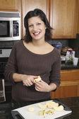 Hispanic woman preparing food — Stock Photo