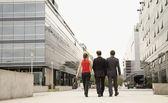 Multi-ethnic businesspeople walking — Stock Photo