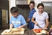 Multi-ethnic family preparing food — Stock Photo