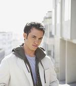 Young man wearing hooded sweatshirt — Stock Photo