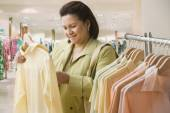 Hispanic woman shopping for clothing — Stock Photo
