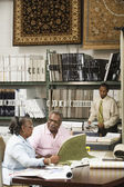 African American couple looking at flooring samples — Stok fotoğraf
