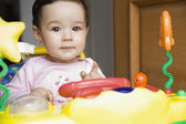 Girl playing with toy — Stock Photo