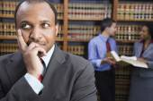 African American businessman in library — Stock Photo