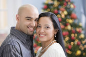 Hispanic couple hugging — Stock Photo