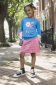 African girl standing on sidewalk — Stock Photo