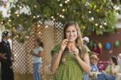 Hispanic girl blowing bubbles — Stock Photo