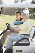 Asian father and adult son in golf cart — Foto de Stock
