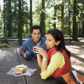 Indian couple eating lunch in woods — Stock Photo