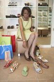 Senior African American woman shoe shopping — Foto Stock