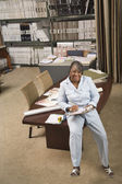 African American sales representative in flooring store — Stock Photo