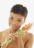 African American woman holding flowers — Stock Photo