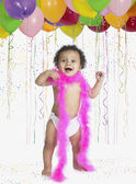 African baby wearing feather boa at party — Stockfoto
