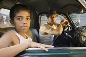 Hispanic father and son sitting in truck — Stock Photo