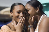 African teenaged girls telling secret — Stock Photo