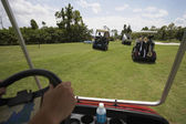 Golf carts driving on golf course — Stock Photo